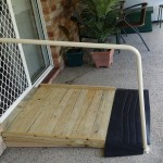 Photo of small timber ramp with handrail