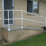 Photo of handrail at landing and stairs