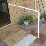 Photo of handrail, timber ramp and checkerplate end